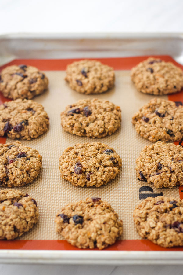 Baked oatmeal cookies on a quarter sheet pan.
