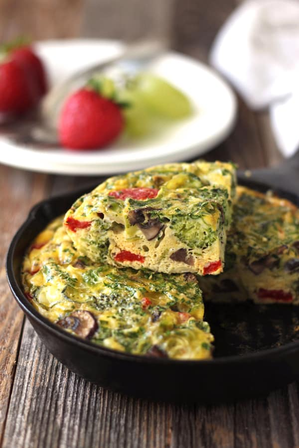 Toaster oven frittata is stuffed full of veggies, high in protein and tastes so darn good you'll want to eat it all day, every day. Sized to fit your little toaster oven it makes a tasty dinner or Sunday brunch for two.