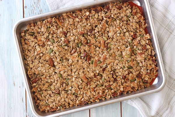 Cooked toaster oven granola in a quarter sheet pan