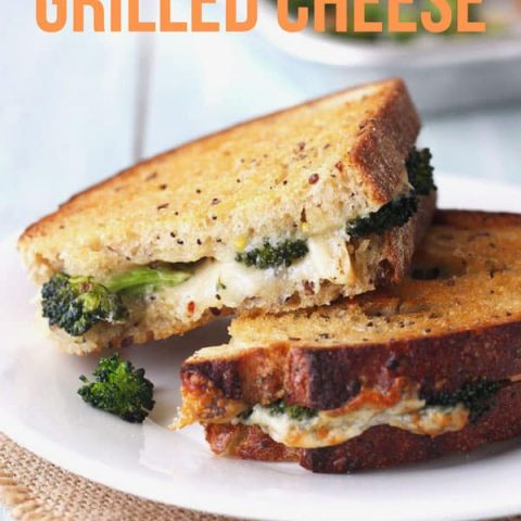 Toaster oven grilled cheese sandwich stuffed with roasted broccoli on a plate.
