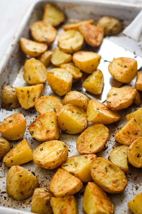 Golden roasted potatoes on a quarter sheet pan.