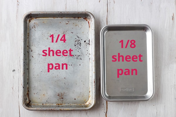 Metal quarter sheet pan and eight sheet pan side by side.